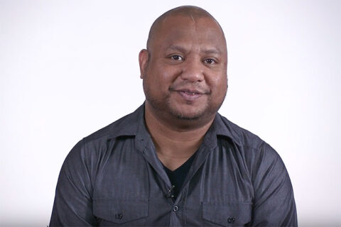 african American male talking to the camera on white background