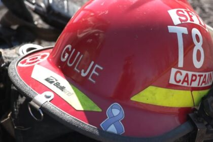 red firefighter helmet with name marked gulag